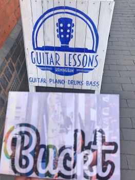 Buckt with Guitar A board