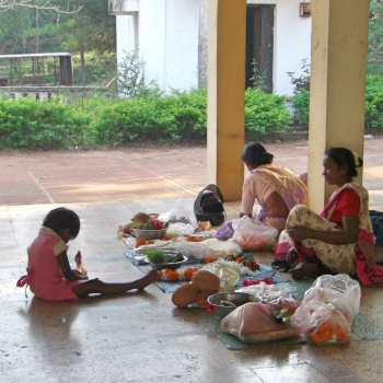 Making flower garlands at a temple in Goa