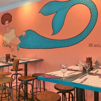 Pretty interior of the restaurant with mermaid