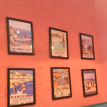 Wall with seaside town frames