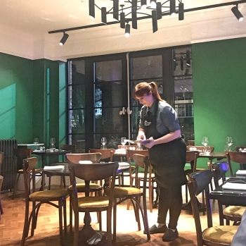 Staff member setting table
