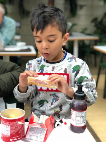 Nephew enjoying lunch